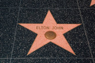 Elton John start on the pavement on walk of fame in Los Angeles, California. August 10, 2017