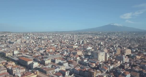 Beautiful aerial view of the Catania city near the main Cathedral and Etna volcano on the background. Amazing old town view from above.