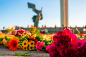 Victory Day holiday concept. flowers, old military cap, traditional symbol of 9 may, Victory Day 1945.