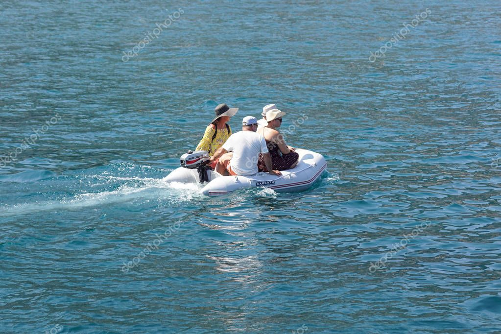 Nice , France - 7 august 2017 : small inflatable boat used to carry people from the beach to boats moored off the sea. boat tender