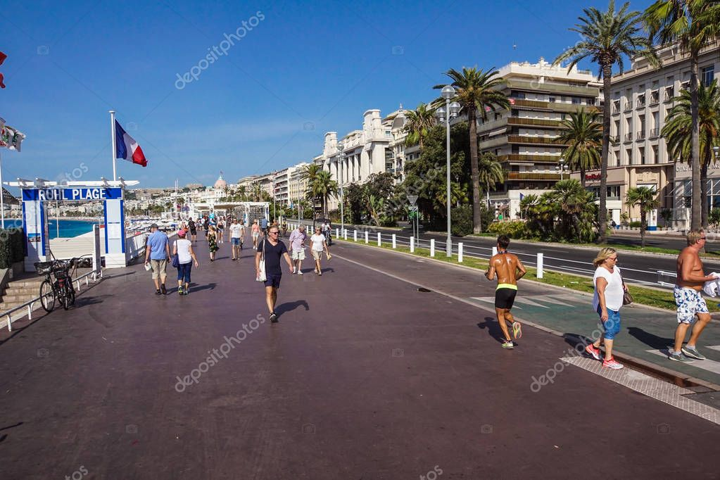 NICE, FRANCE - july 14, 2017: Tourists and local people walking on the charming vintage streets of Old town in Nice, France.