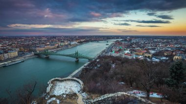 Budapest, Hungary - Beautiful sunset over the city of Budapest with River Danube, Szabadsag Bridge and Gellert Bath taken from Gellert Hill