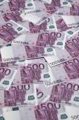 Zblízka pozadí fotografie výše pěti set poznámky měny Evropské unie. Mnoho růžové 500 euro bankovky jsou vedle sebe. Symbolické textury fotografií pro bohatství
