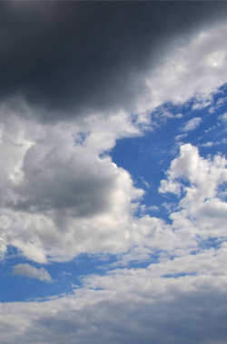 Image of a cloudy blue sky in a gloomy and ragged day