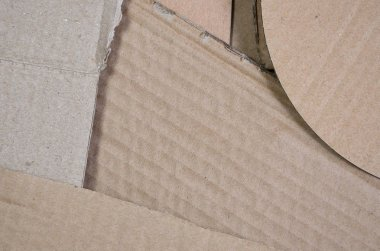 Background image with a lot of beige cardboard paper, which is used to make boxes for the transport of home appliances and postal parcels. Carton texture