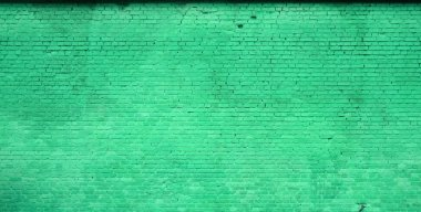 The texture of the brick wall of many rows of bricks painted in green color stock vector