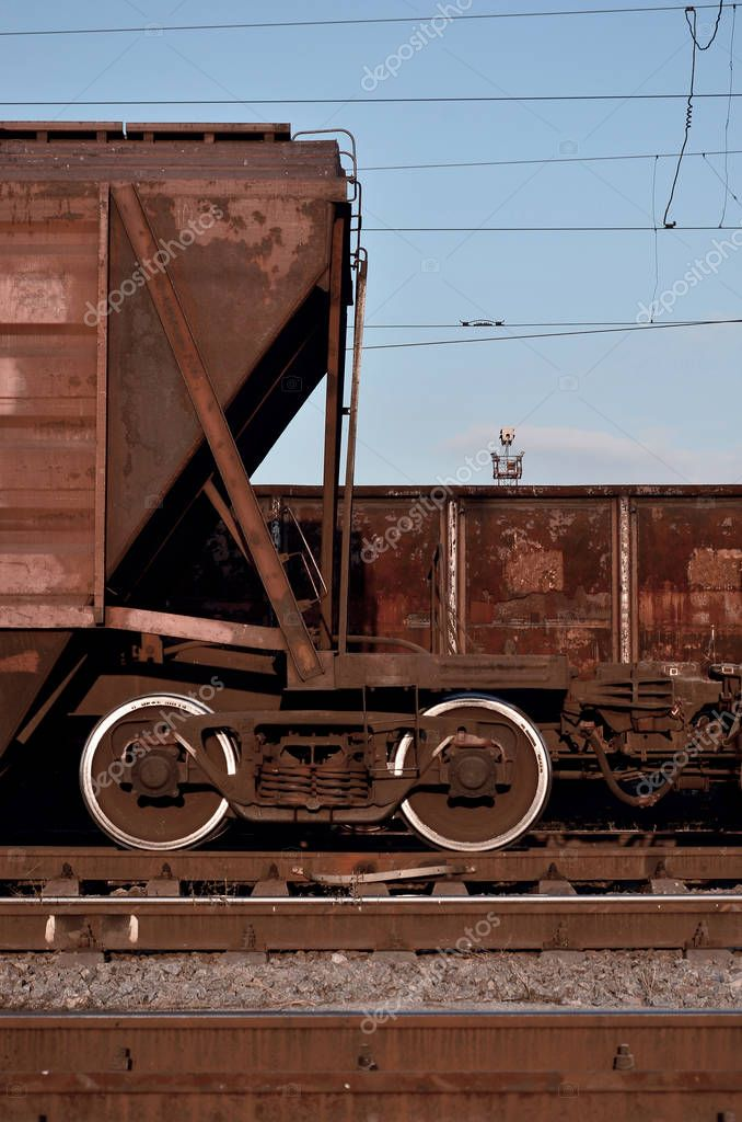 Detailed photo of railway freight car. A fragment of the component parts of the freight car on the railroad in daylight