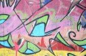 Fotografie Detail fragment graffiti kreslení na zdi vyrovnány aerosolové barvy. Obrázek na pozadí moderní složení čar a barevných ploch. Koncept street artu
