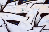 Staré zdi, maloval barevné graffiti kreslení červené aerosolových barev. Obrázek pozadí na téma kreslení graffiti a street art