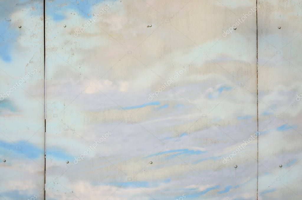 Background texture of wall with graffiti paintings. Blue cloudy sky