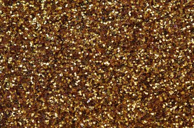 A huge amount of yellow decorative sequins. Background texture with shiny, small elements that reflect light in a random order. Glitter texture