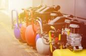 Photo Many new air compressors pressure pumps close up photo
