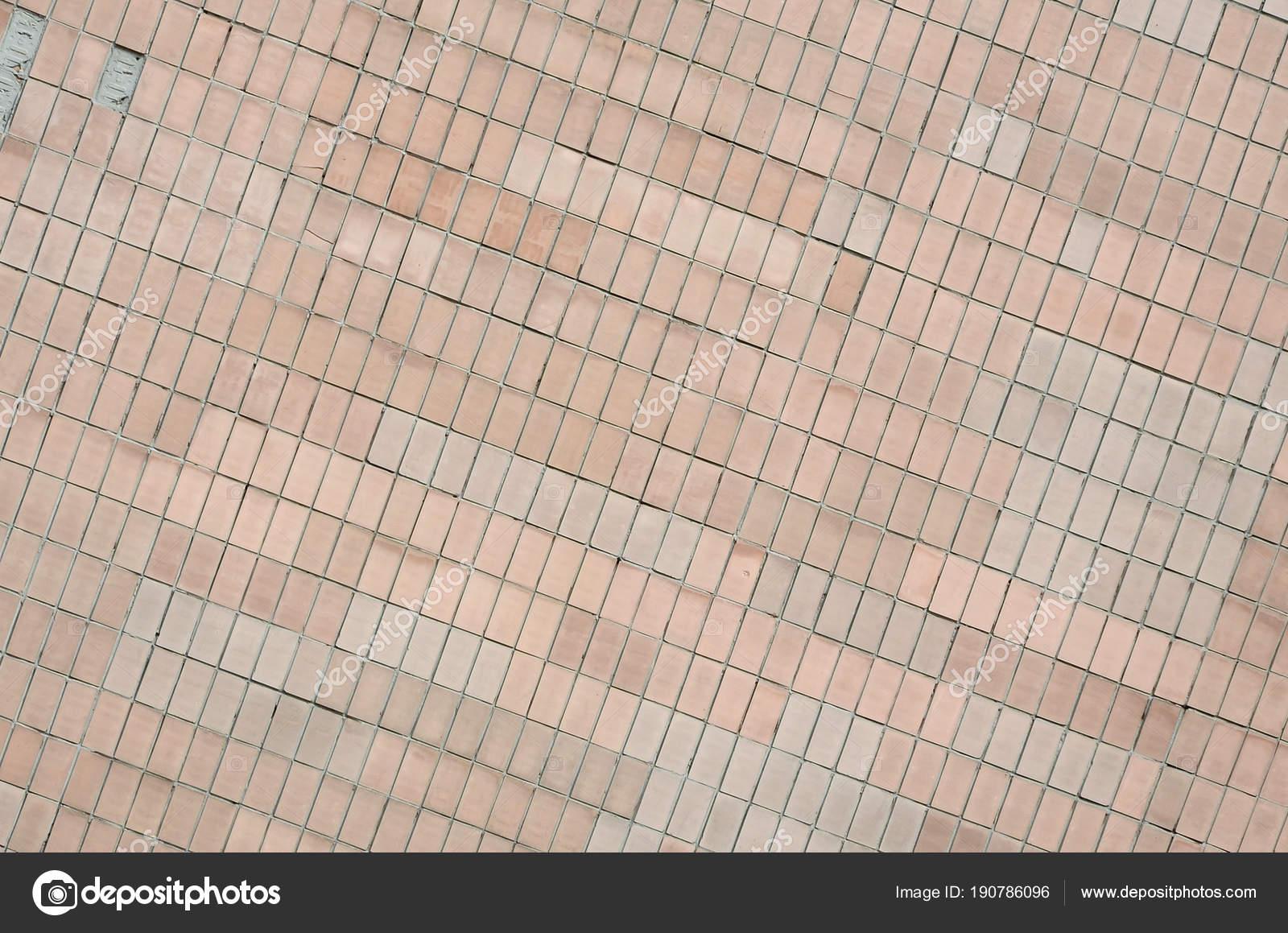 Vecchie piastrelle di parete sovietica beige. la texture del