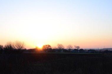 Dawn in the village. Sunrise in the suburban landscape