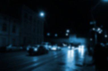 Blurred night scene of traffic on the roadway. Defocused image of cars traveling with luminous headlights. Bokeh Art