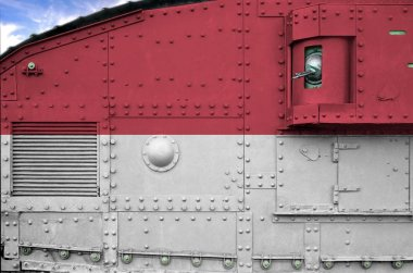 Indonesia flag depicted on side part of military armored tank close up. Army forces conceptual background