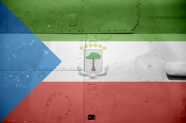 Equatorial Guinea flag depicted on side part of military armored helicopter close up. Army forces aircraft conceptual background