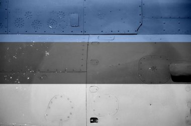 Estonia flag depicted on side part of military armored helicopter close up. Army forces aircraft conceptual background
