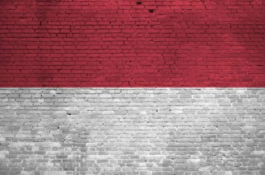 Indonesia flag depicted in paint colors on old brick wall close up. Textured banner on big brick wall masonry background