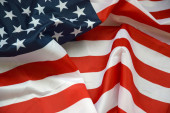 Fotografie United States of America waving flag with many folds