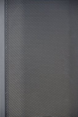 Abstract black metallic mesh texture pattern for Industrial background. Speaker of musical column and free space for text