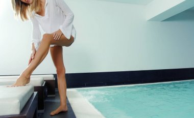 beautiful woman legs care in spa by the pool