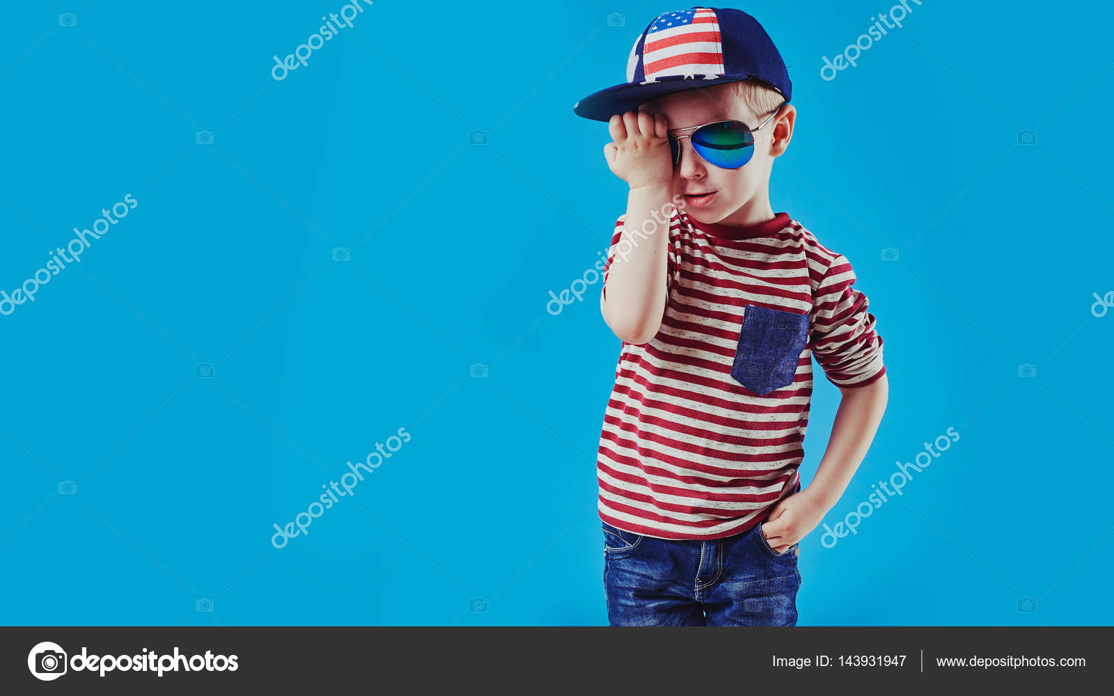 f0eff84a0 Cute little boy in elegant clothes and sunglasses. Kids fashion.– stock  image