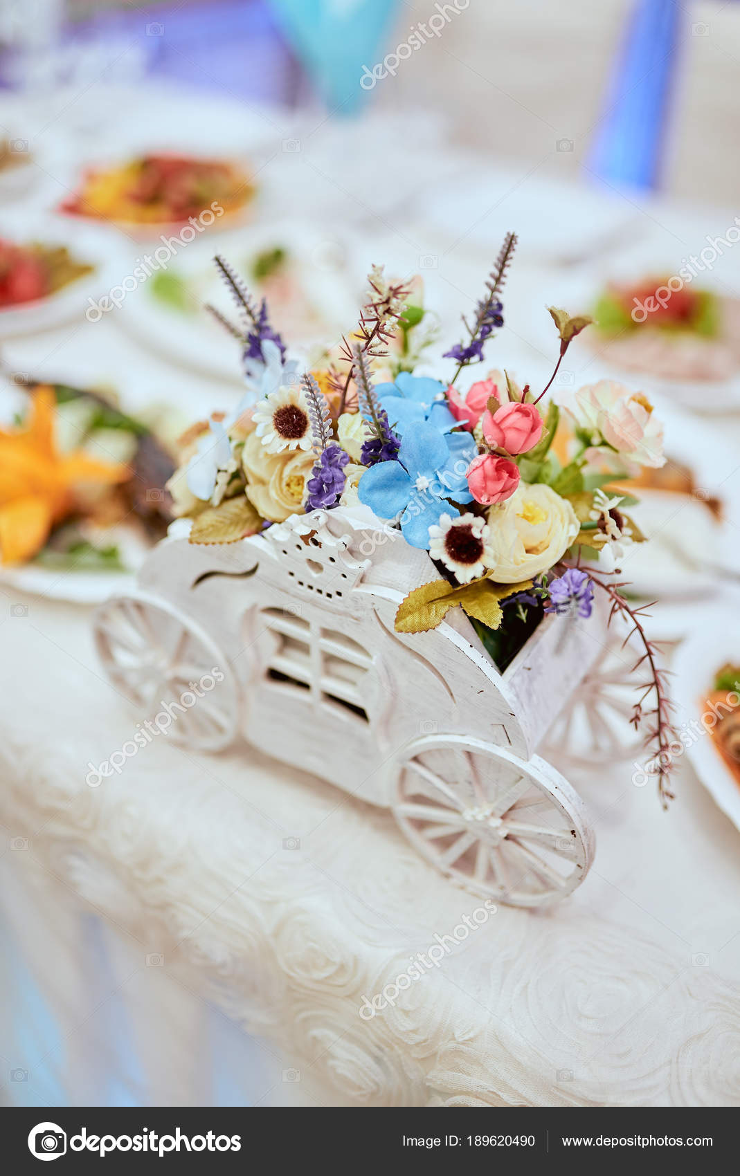 Wedding decor, flowers, rings, bouquet in the hands, rings, groom ...