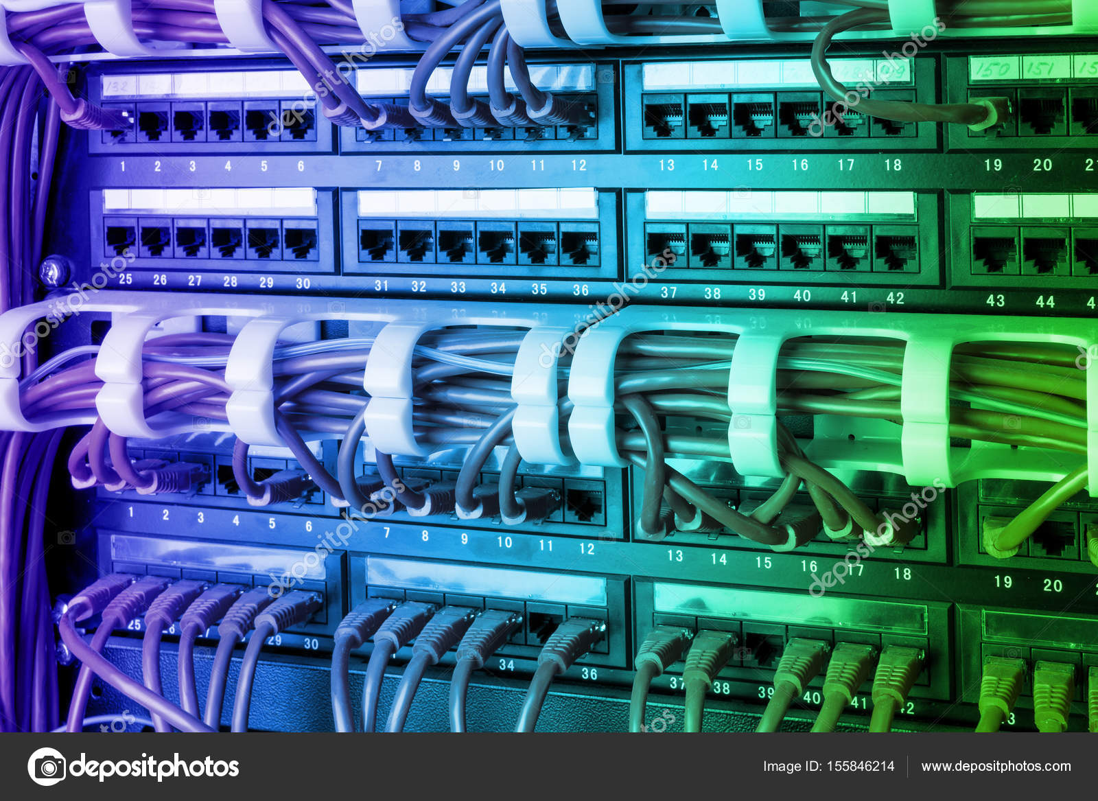 Network panel, switch and internet cable in data center. Black ...