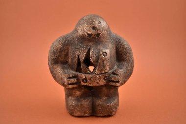 Prague golem stock images. Mystical Jewish creature. Golem on a brown background. Prague golem statuette