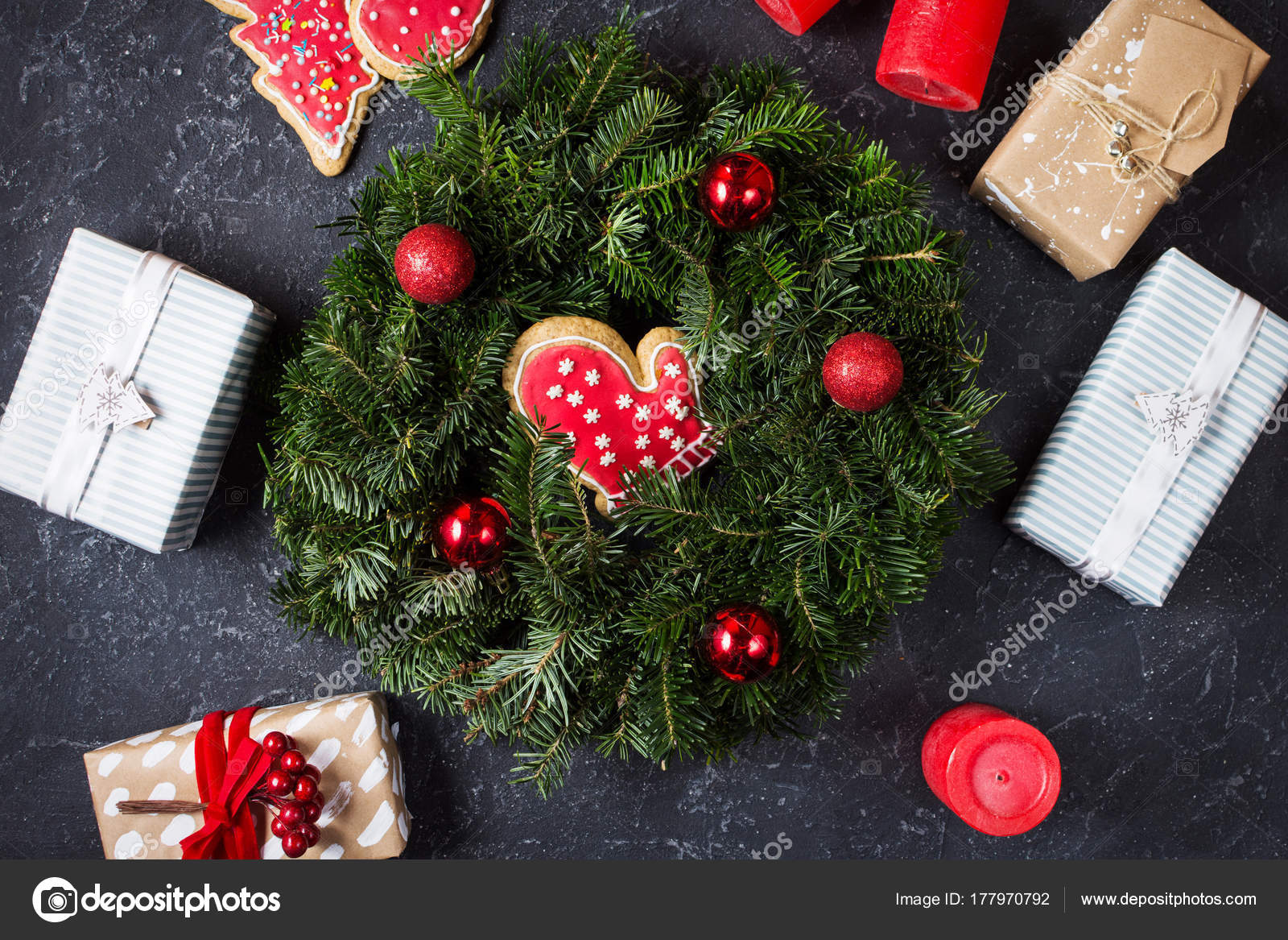 Christmas wreath and Christmas gifts on a black stone surface ...