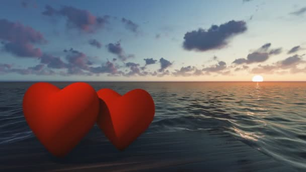 Dvě červené srdce v moři při západu slunce