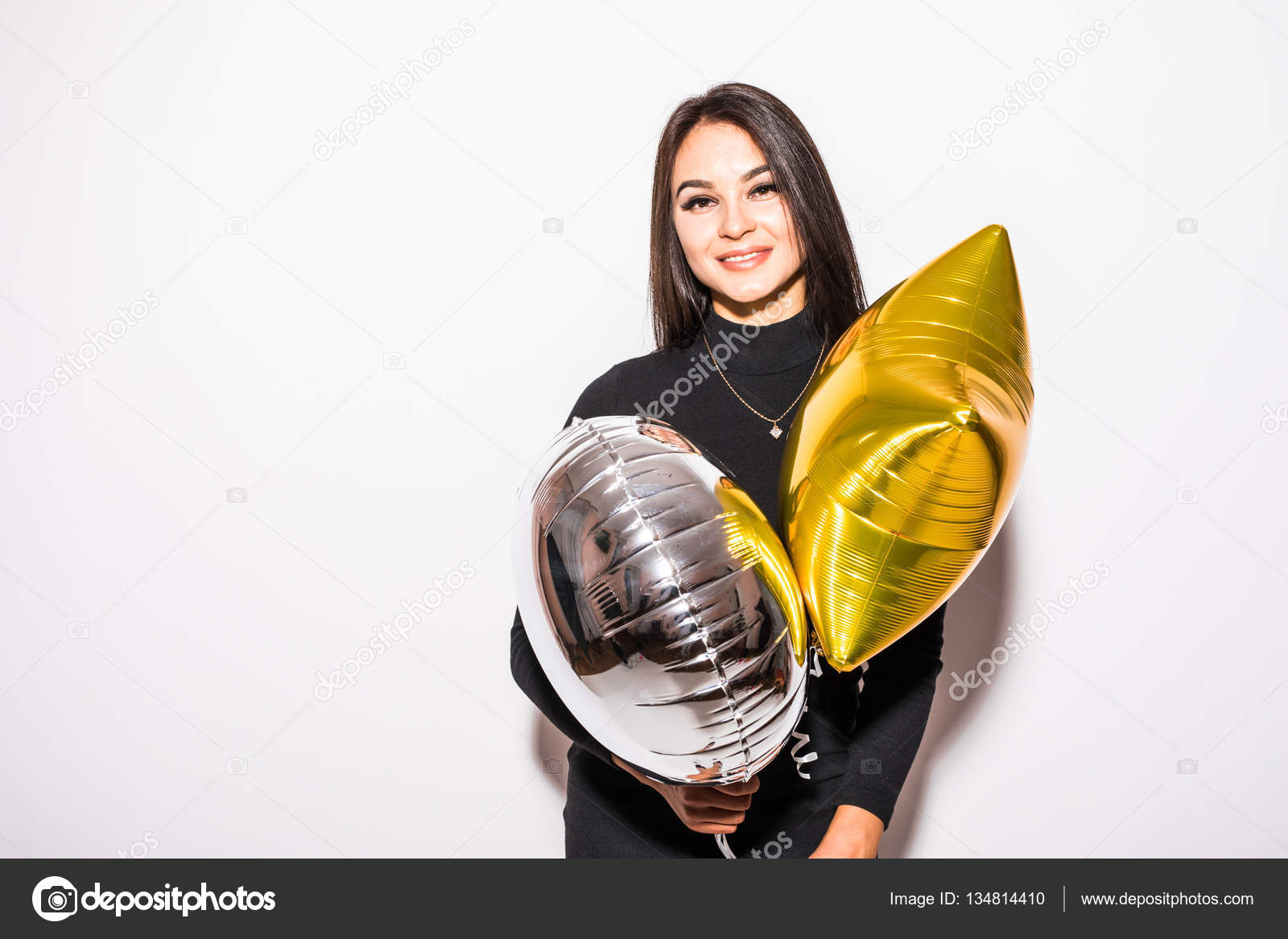 946a679bd68a Pretty young woman in black dress with gold star shaped balloon smiling and drinking  champagne —