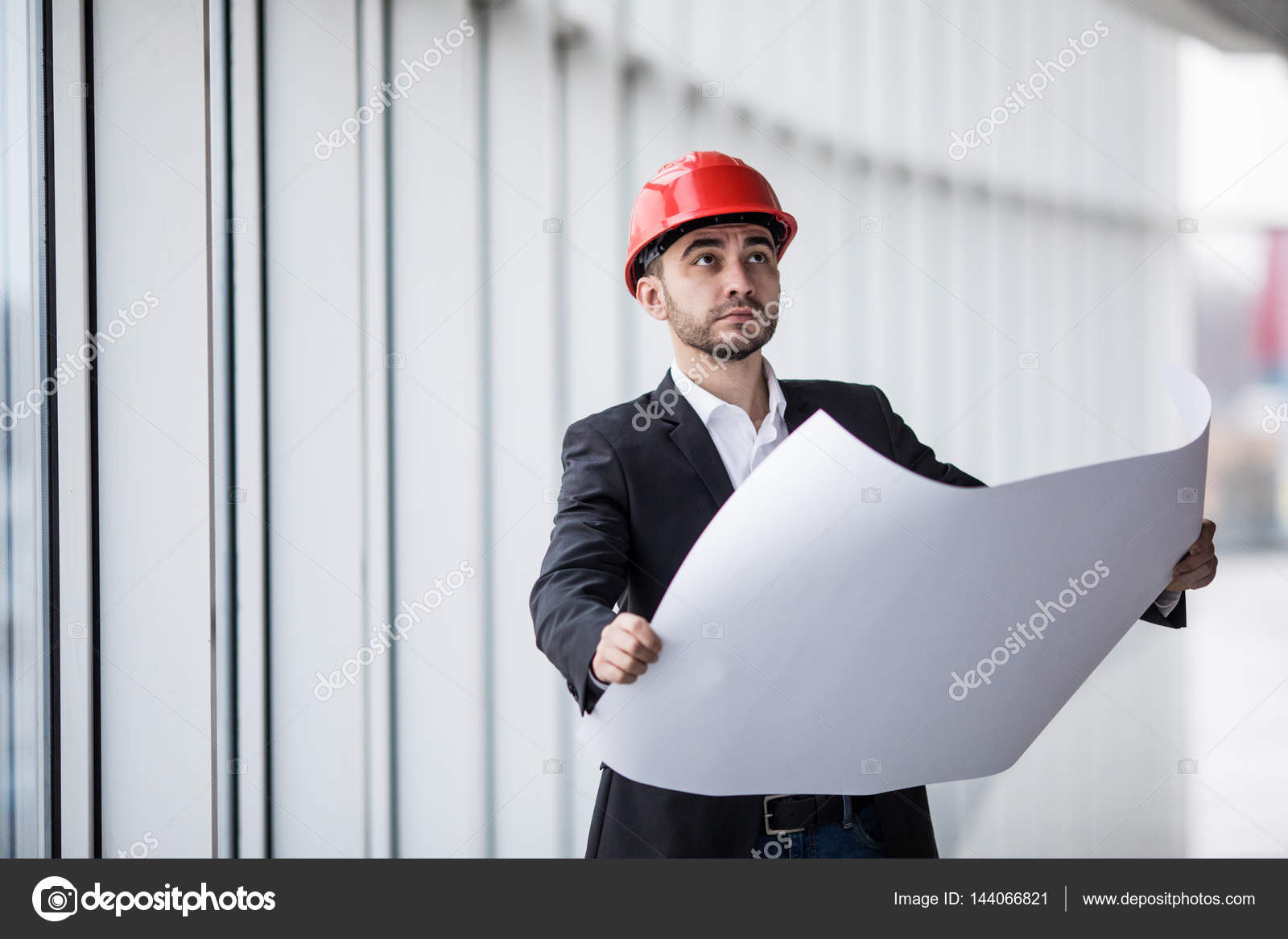 Portrait Of An Architect Builder Studying Layout Plan Of The Building,  Serious Civil Engineer Working