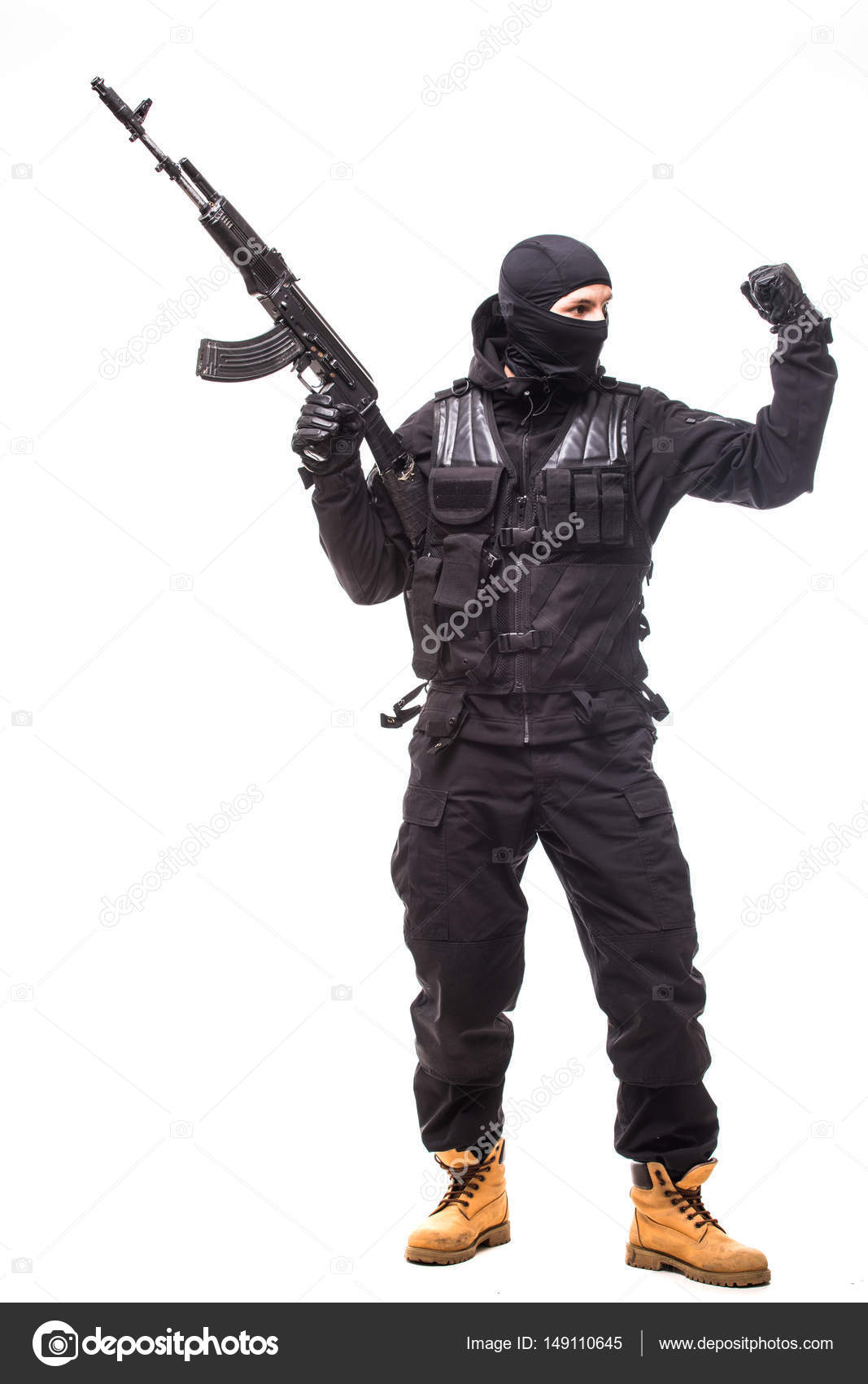 SWAT officer with assault rifle in black uniform isolated on white ...