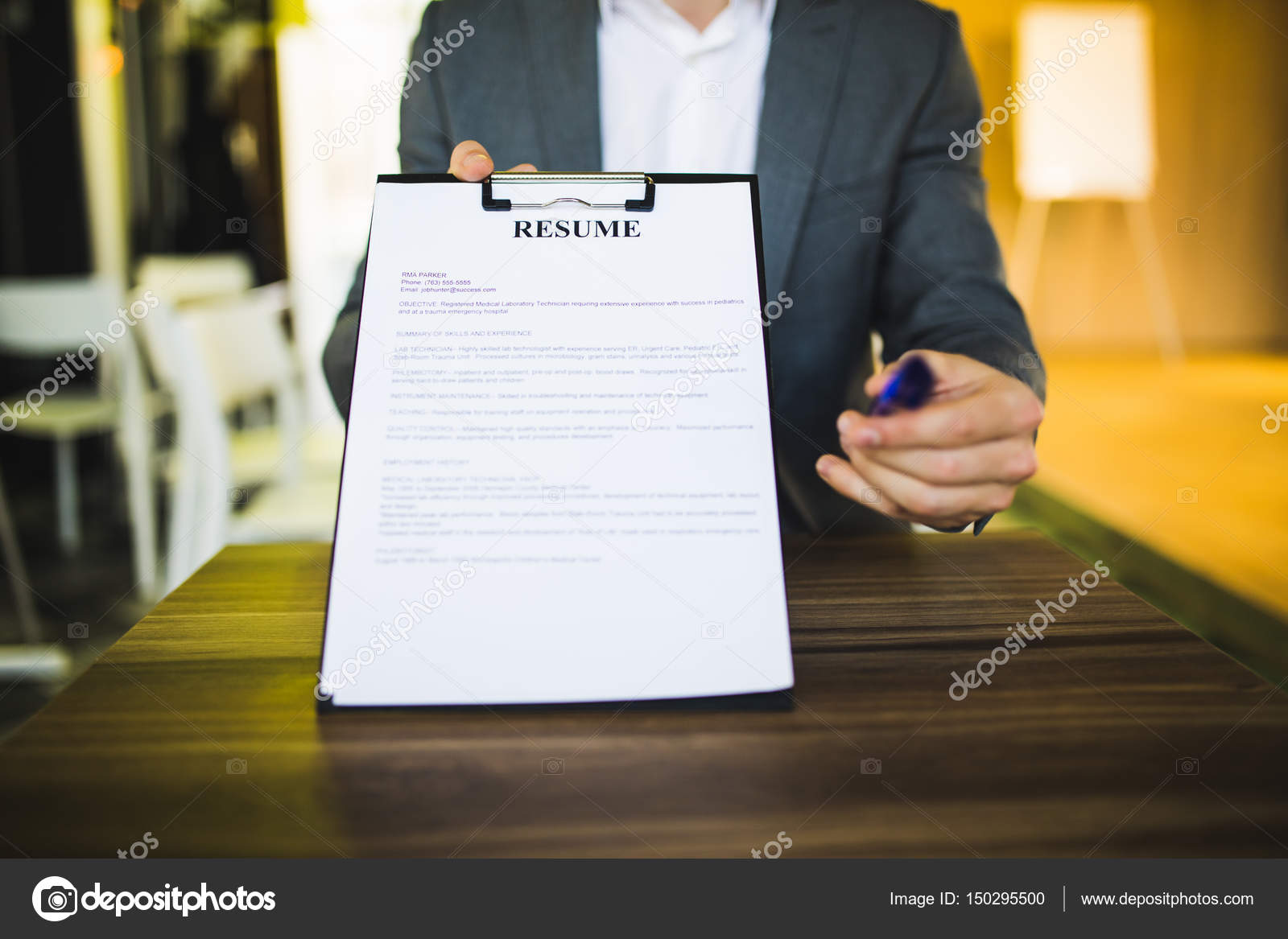 young businessman submitting resume to employer to review stock