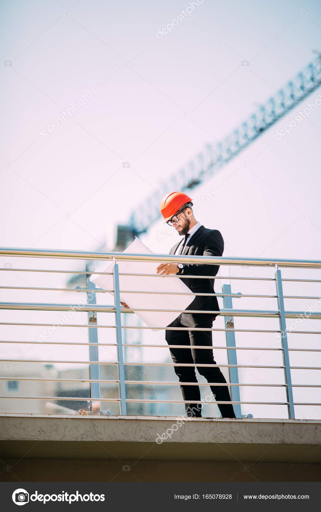 Handsome man engineering consulting people on construction site handsome man engineering consulting people on construction site holding blueprint in his hand building inspector malvernweather Image collections