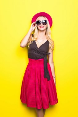 Young cool trendy fashion woman on yellow background