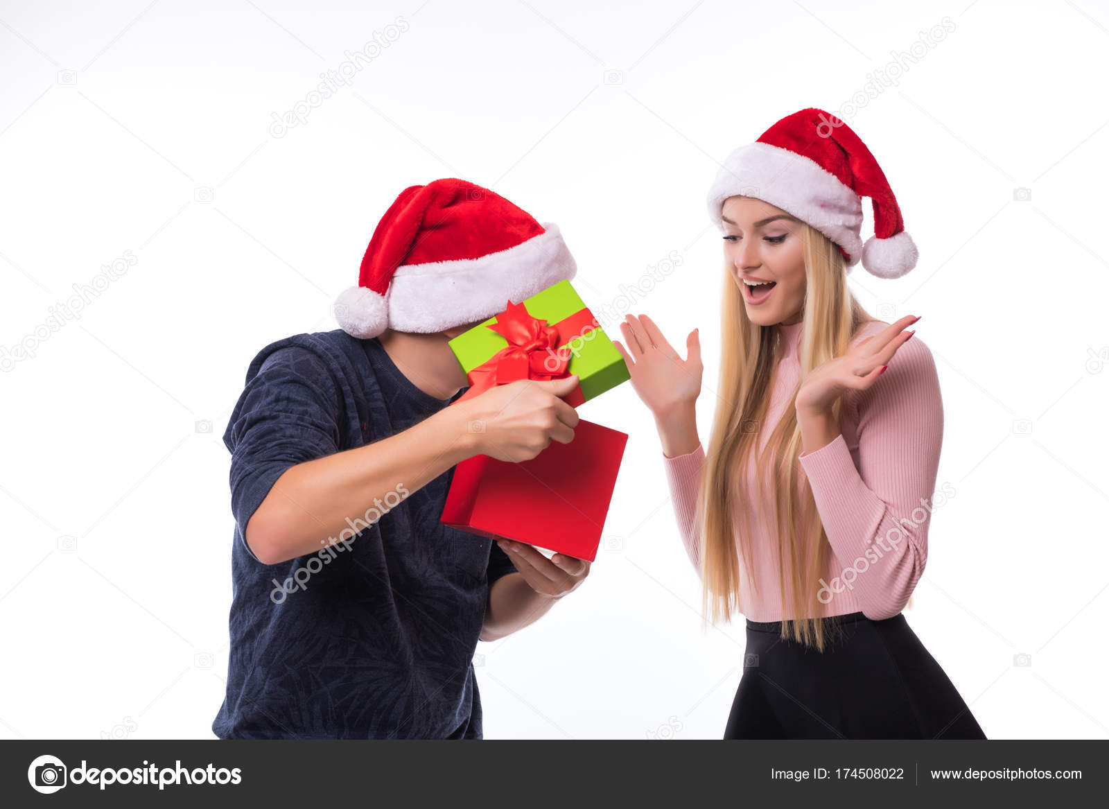 happy young couple with christmas present on white background man open gift for woman christmas