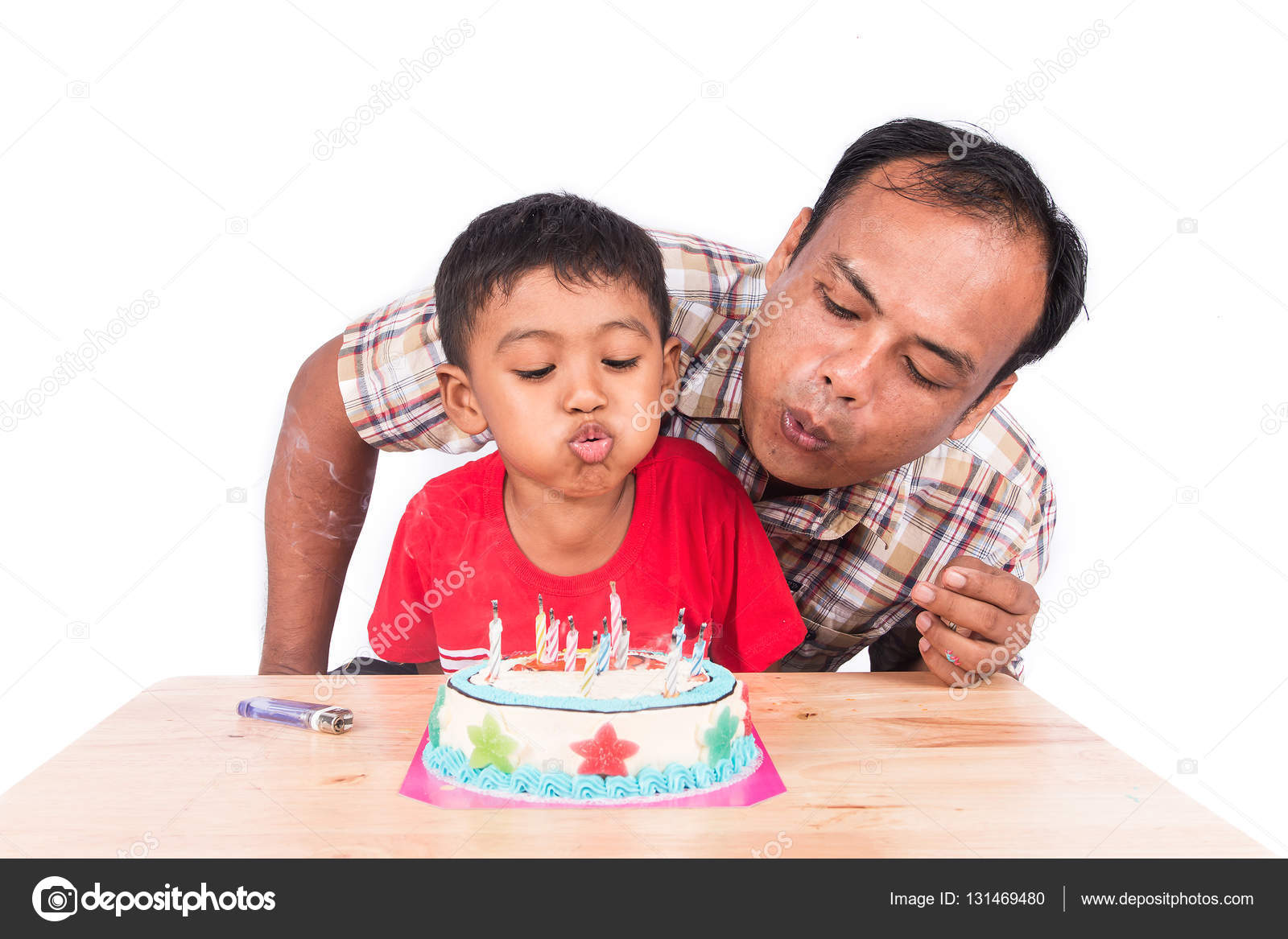 Cute Little Child Boy With His Father Blowing Birthday Cake Stock Image