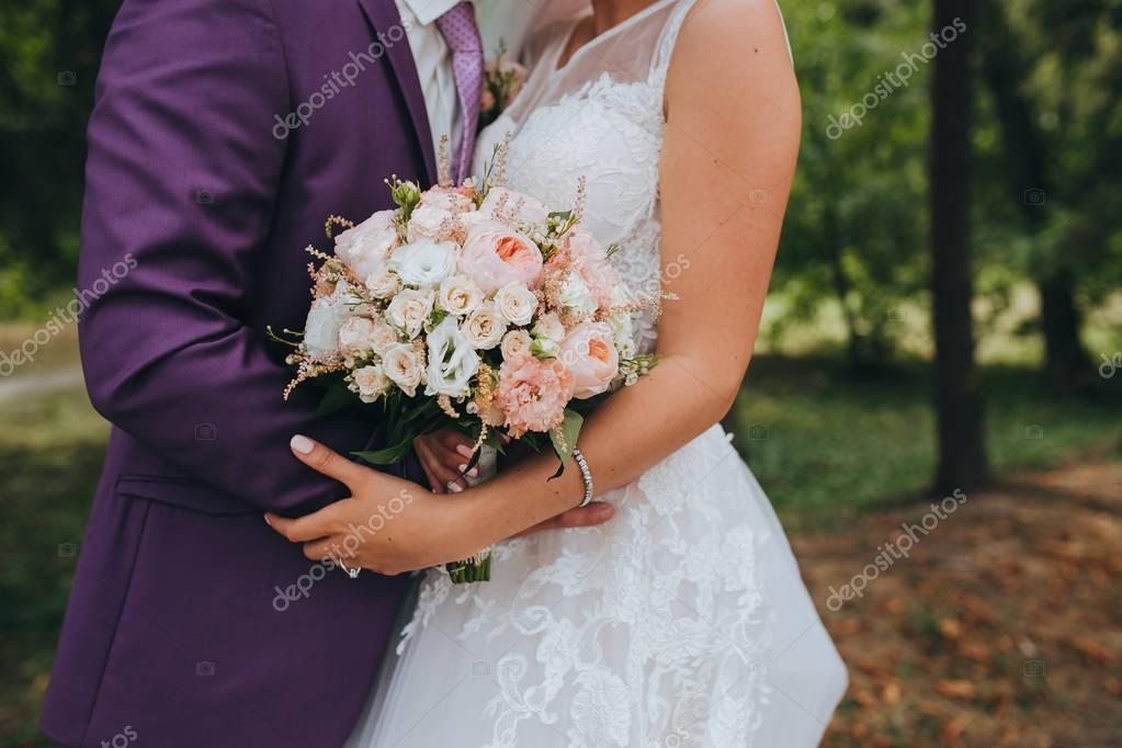 Wedding flower composition in hands