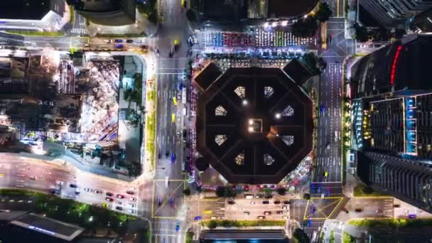 4K hyperlapse time-lapse of car traffic transportation and under construction site, crane at night in city downtown. Drone aerial top view. Industrial business or civil engineering technology concept