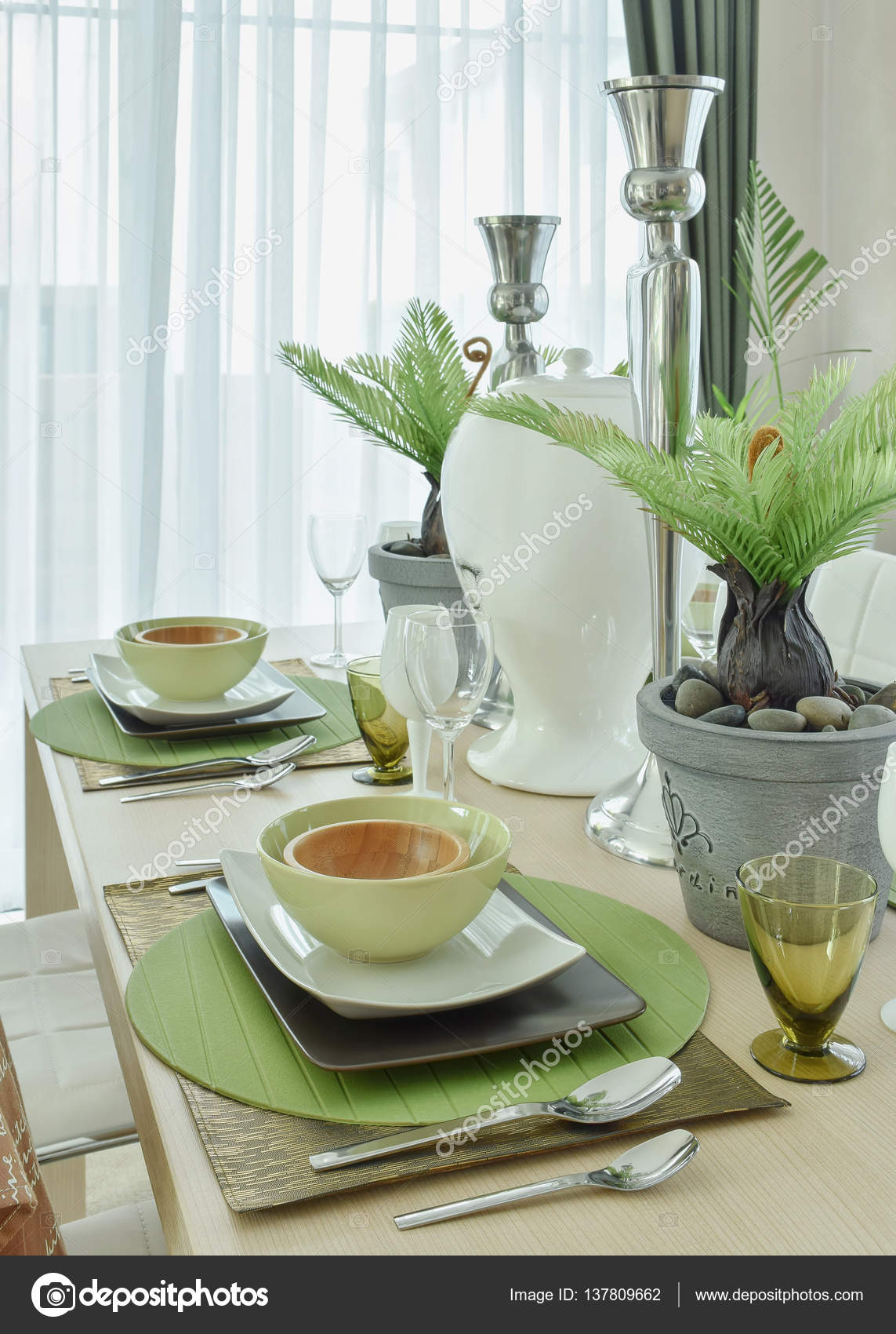 Beautiful Modern Ceramic Tableware In Green Color Scheme Setting On Dining Table Stock Image