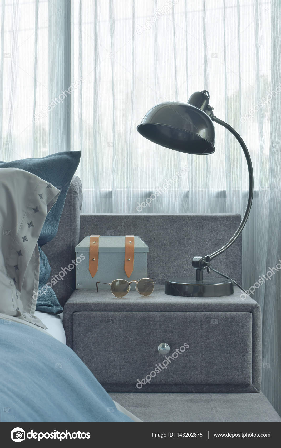 Industrial Style Reading Lamp Next To Blue Color Scheme Bedding Stock Photo