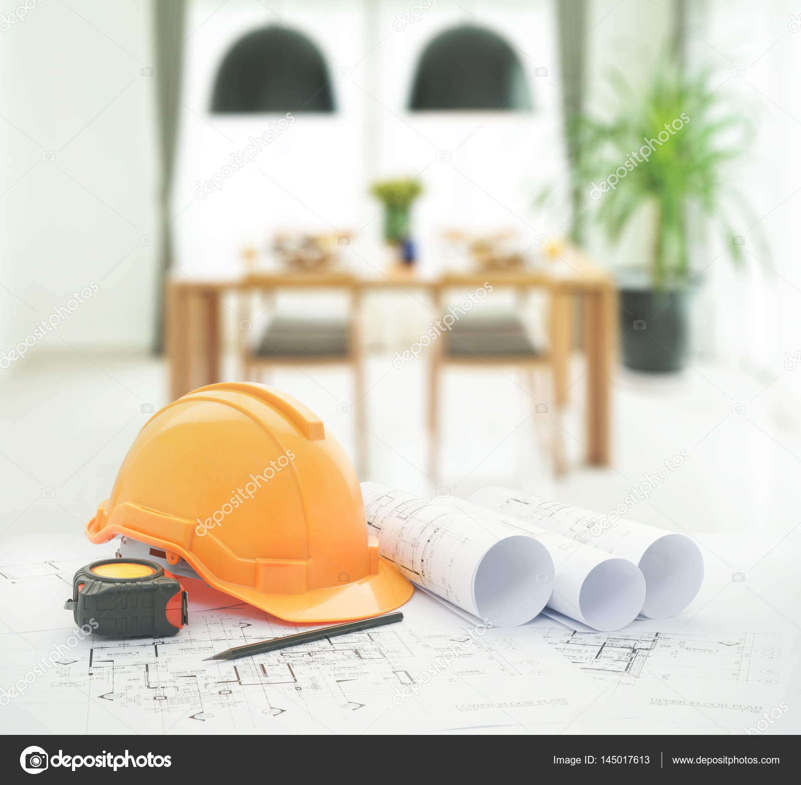 Architectural blueprint with safety helmet and tools over dining architectural blueprint with safety helmet and tools over dining table and comfortable chairs in modern home photo by worldwidestock malvernweather Gallery