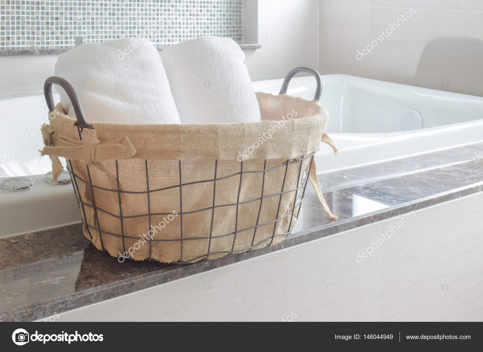 Towels in basket next to white bathtub in the bathroom — Stock Photo ...