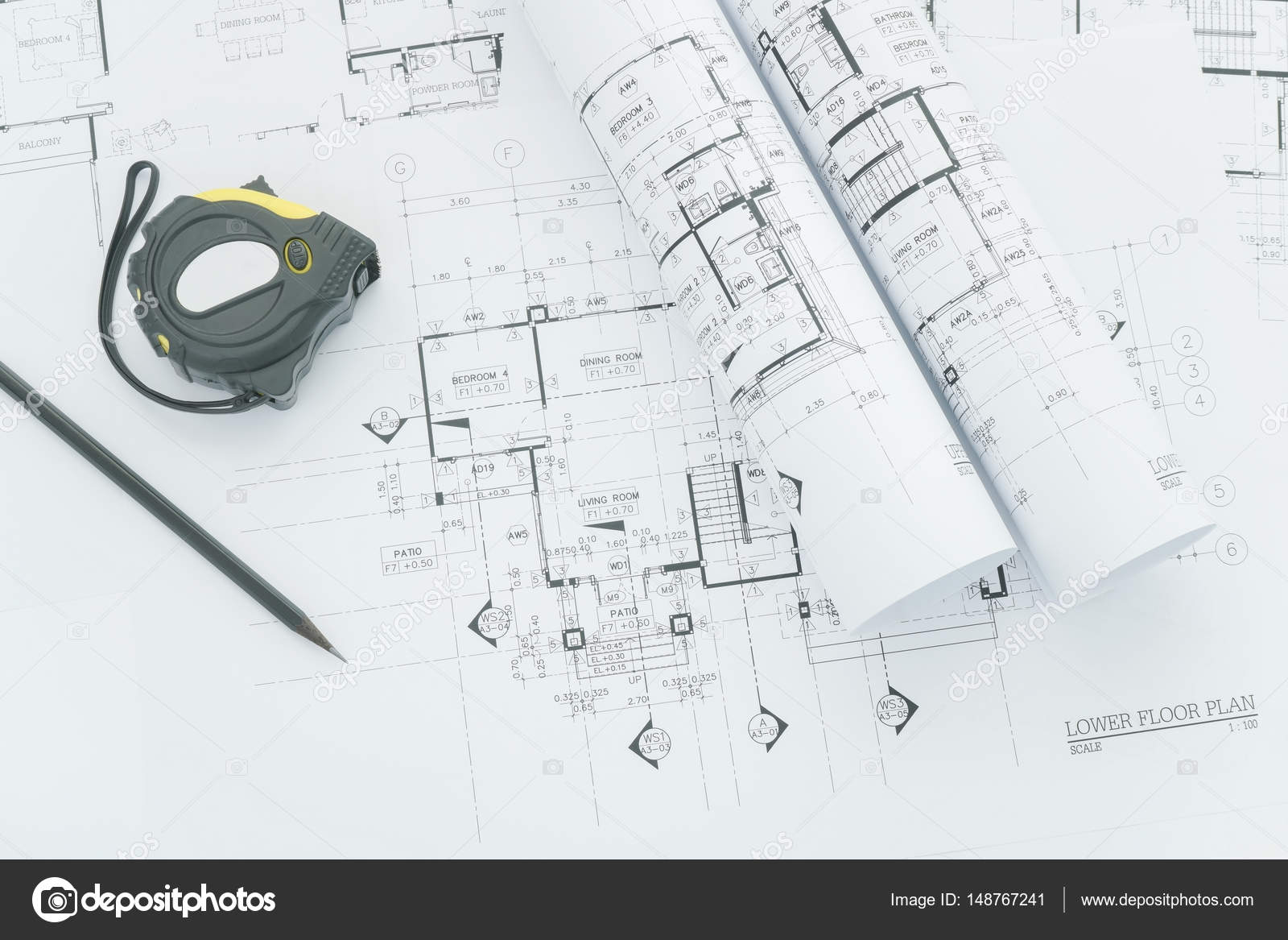 Architects workplace architectural blueprints with measuring tape architects workplace architectural blueprints with measuring tape safety helmet and tools on table top view photo by worldwidestock malvernweather Image collections