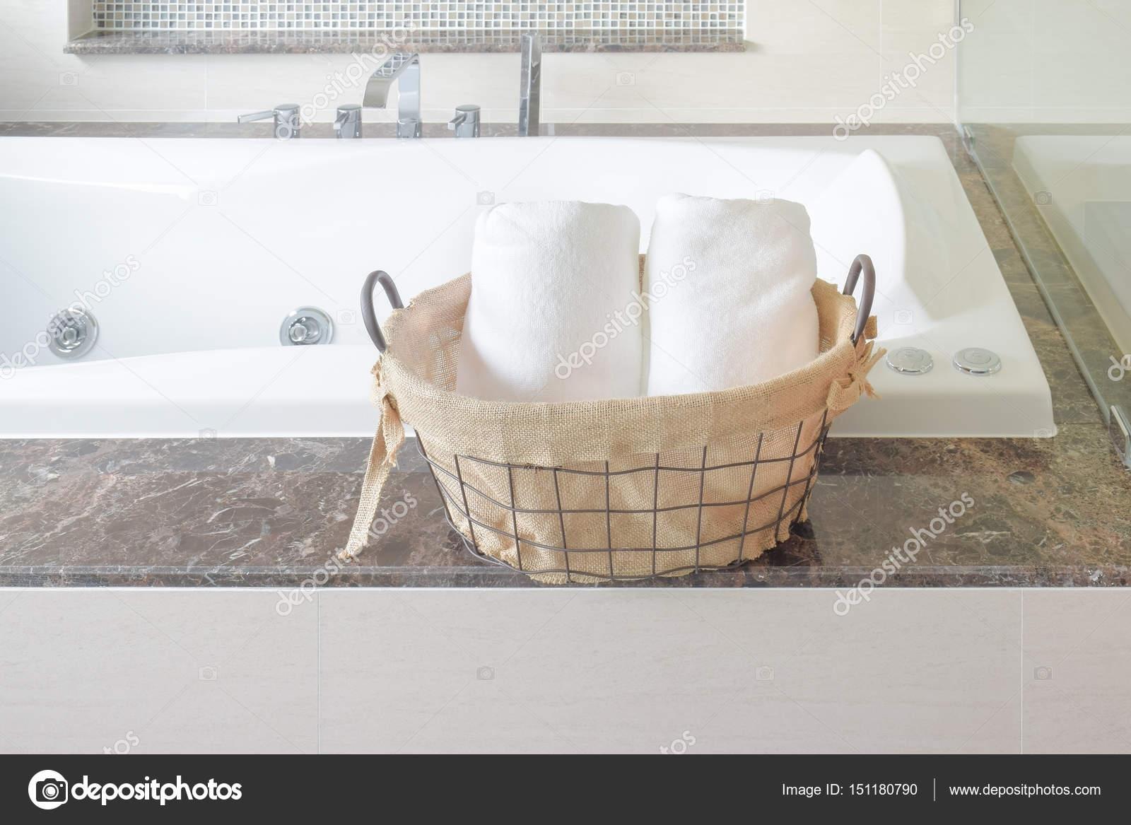 Towel in basket naxt to bathtub in the bathroom — Stock Photo ...