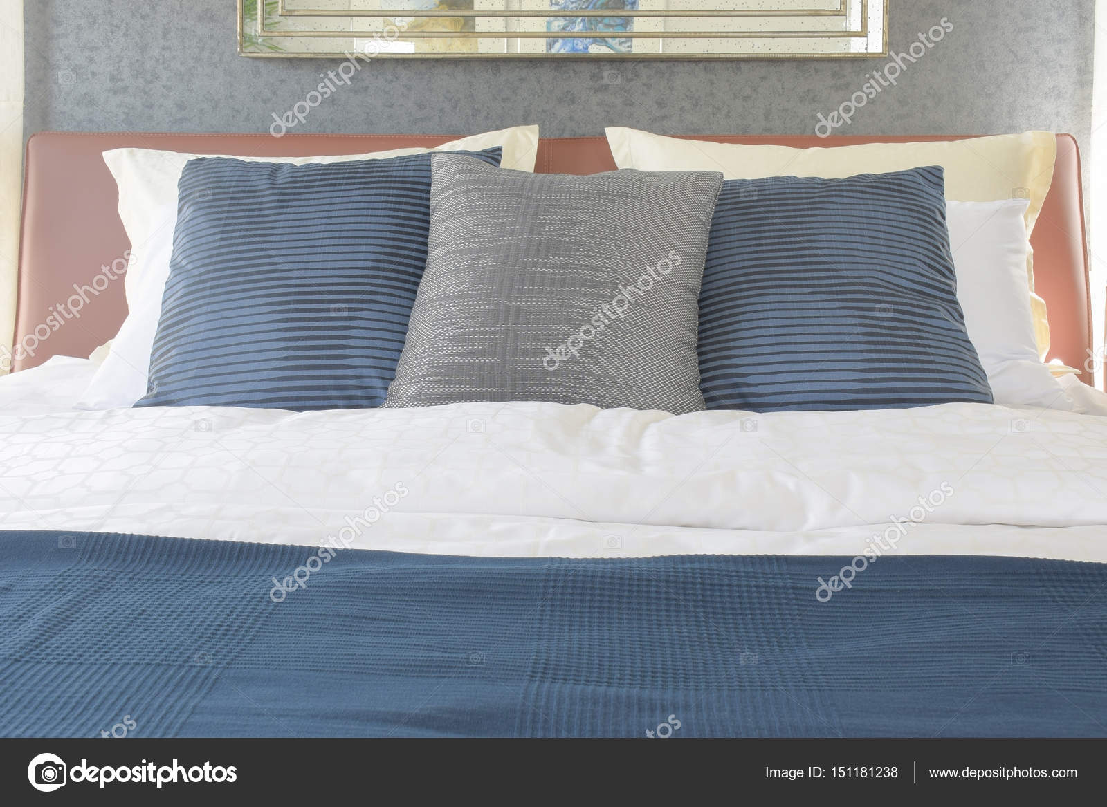 Dark Blue And Gray Pillow On Bed With Brown Leather Headboard Stock Photo C Worldwide Stock 151181238