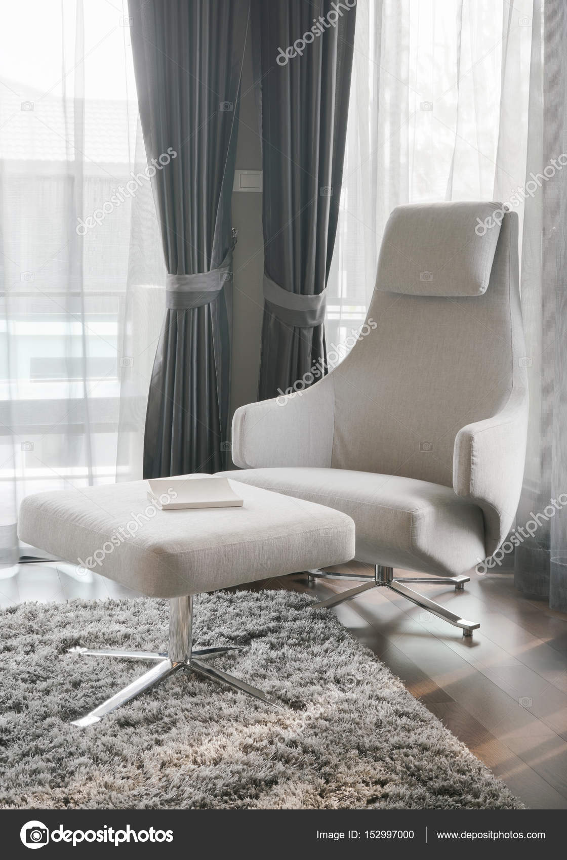 Modern Style Armchair With Ottoman At The Corner Of Living